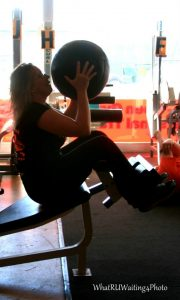 Linda M Hughes doing medicine ball situps on the decline bench
