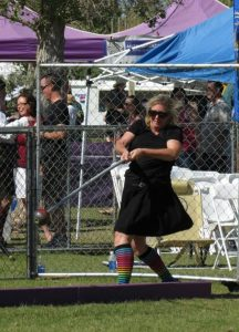 Linda M Hughes throws heavy hammer